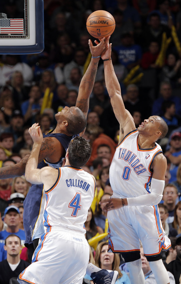 Oklahoma City\'s Russell Westbrook (0) and Nick Collison (4) go after a rebound against Memphis\' Marreese Speights (5) during the NBA basketball game between the Oklahoma City Thunder and the Memphis Grizzlies at Chesapeake Energy Arena on Wednesday, Nov. 14, 2012, in Oklahoma City, Okla. Photo by Chris Landsberger, The Oklahoman