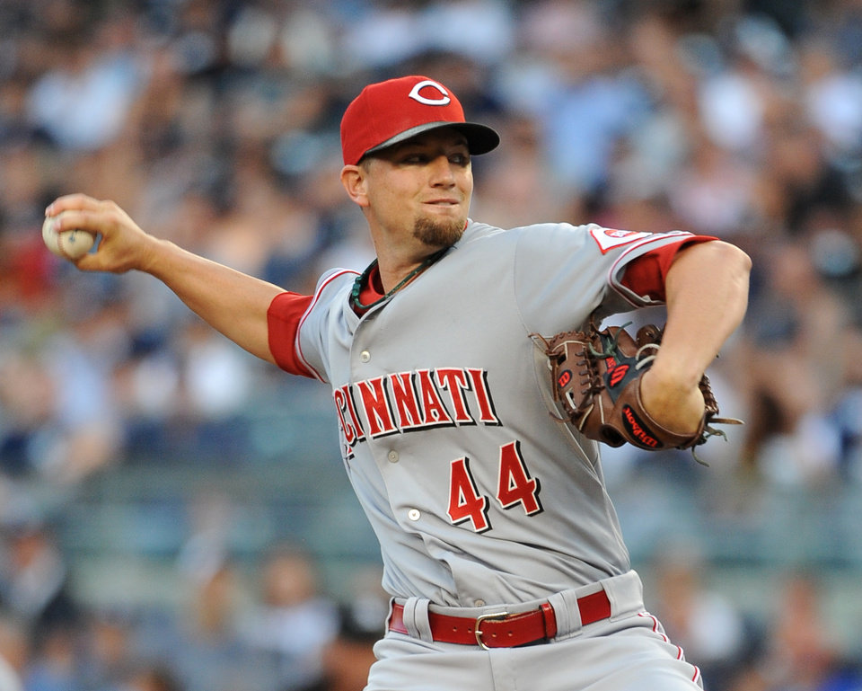 Photo - Cincinnati Reds starter Mike Leake throws against the New York Yankees in the first inning of an interleague baseball game at Yankee Stadium on Friday, July 18, 2014, in New York. (AP Photo/Kathy Kmonicek)