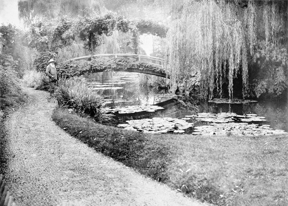 Photo - This photo provided by the New York Botanical Garden shows French impressionist artist Claude Monet in his garden in Giverny, France.  AP Photo/New York Botanical Garden