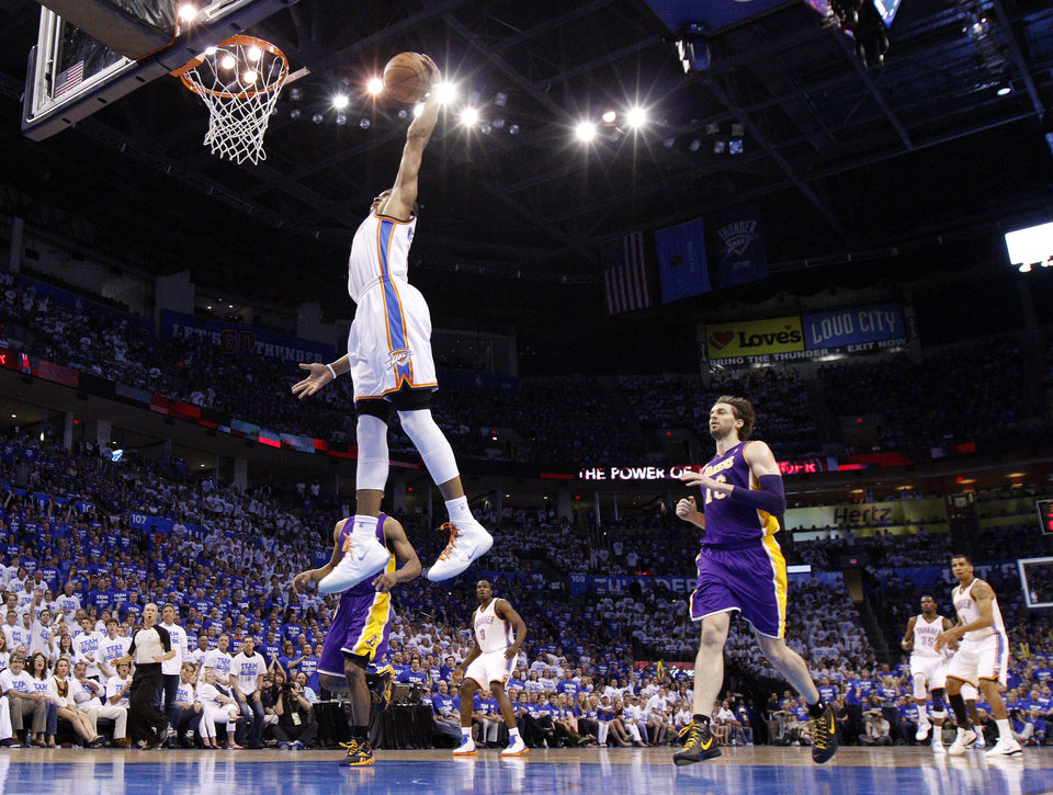 Photo - Oklahoma City's Russell Westbrook (0) goes up for a dunk during Game 2 in the second round of the NBA playoffs between the Oklahoma City Thunder and L.A. Lakers at Chesapeake Energy Arena in Oklahoma City, Wednesday, May 16, 2012. Photo by Bryan Terry, The Oklahoman