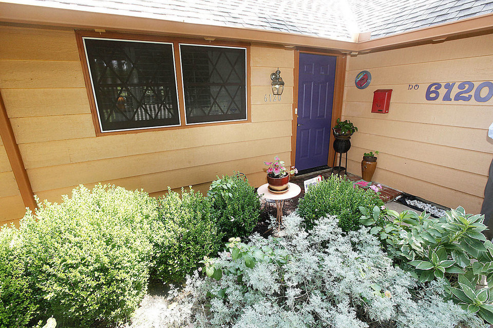 "Heavy landcaping helps put the ""garden"" in the ""Garden View"" emphasis of the ""storybook ranch"" style homes in the Rollingwood neighborhood near NW 63 and Meridian Avenue. <strong>PAUL HELLSTERN - The Oklahoman</strong>"