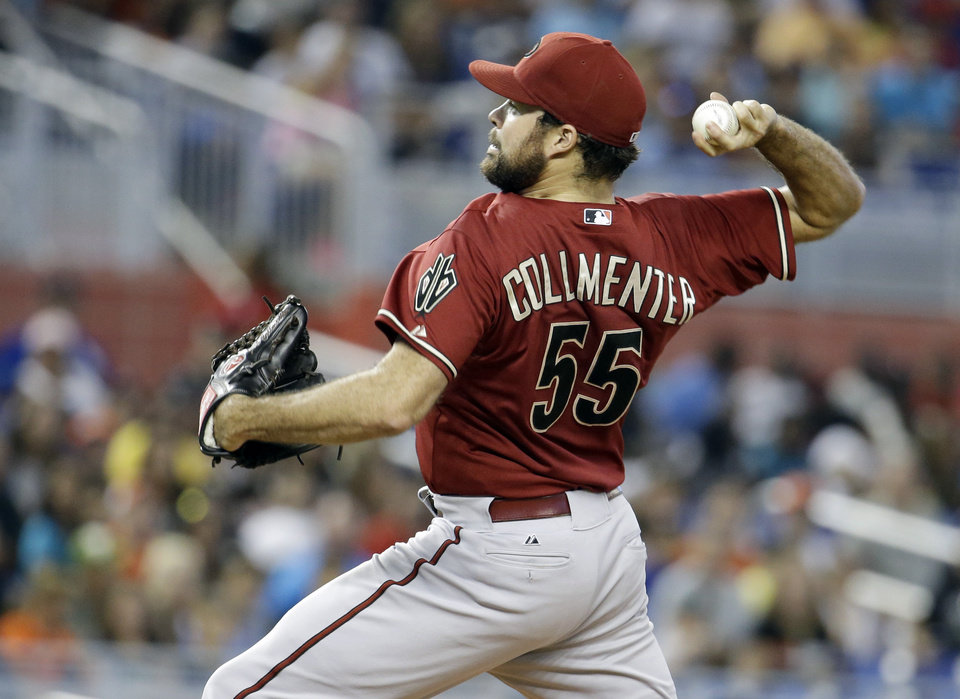 Photo - Arizona Diamondbacks starting pitcher Josh Collmenter (55) throws in the first inning during a baseball game against the Miami Marlins, Sunday, Aug. 17, 2014, in Miami. (AP Photo/Lynne Sladky)