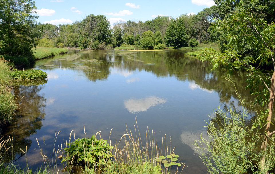 Photo -   The Kalamazoo River is visible from Saylor's Landing west of Marshall , Mich., on Tuesday, July 10, 2012. A Canadian company's failure to deal adequately with cracks in an oil pipeline and its slow response to a 2010 rupture in southwestern Michigan likely caused the most expensive onshore oil spill in U.S. history, the National Transportation Safety Board said Tuesday. The spill dumped about 843,000 gallons of heavy crude into the Kalamazoo River and a tributary creek, fouling more than 35 miles of waterways and wetlands. About 320 people reported symptoms from crude oil exposure. (AP Photo/The Enquirer, John Grap) NO SALES
