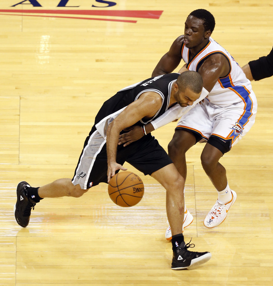 Photo - San Antonio's Tony Parker (9) tries to get by Oklahoma City's Reggie Jackson (15) during Game 6 of the Western Conference Finals in the NBA playoffs between the Oklahoma City Thunder and the San Antonio Spurs at Chesapeake Energy Arena in Oklahoma City, Saturday, May 31, 2014. Photo by Nate Billings, The Oklahoman