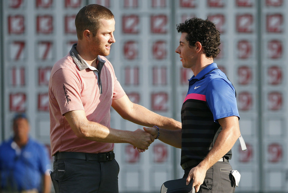 Photo - Chris Kirk, left, shakes hands with Rory McIlroy after finishing on the 18th hole of the  Deutsche Bank Championship golf tournament in Norton, Mass., Monday, Sept. 1, 2014. Kirk won with 15-under par. (AP Photo/Michael Dwyer)