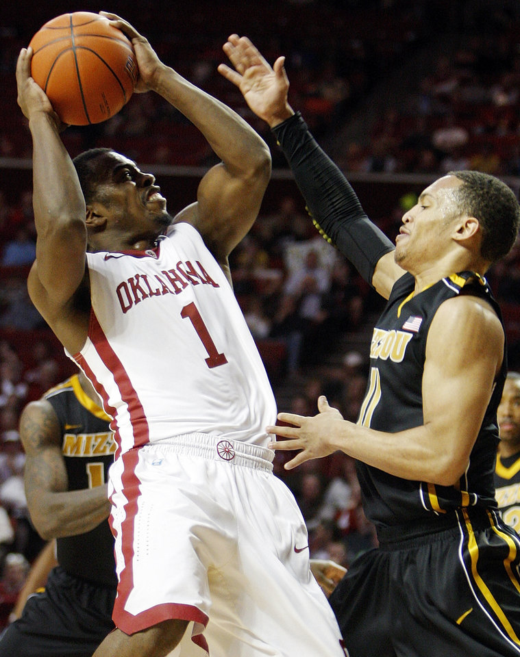 OU's Sam Grooms (1) shoots over Missouri's Michael Dixon (11) in the second half during a men's college basketball game between the University of Oklahoma Sooners and University of Missouri Tigers at the Lloyd Noble Center in Norman, Okla., Monday, Feb. 6, 2012. Missouri won, 71-68.  Photo by Nate Billings, The Oklahoman