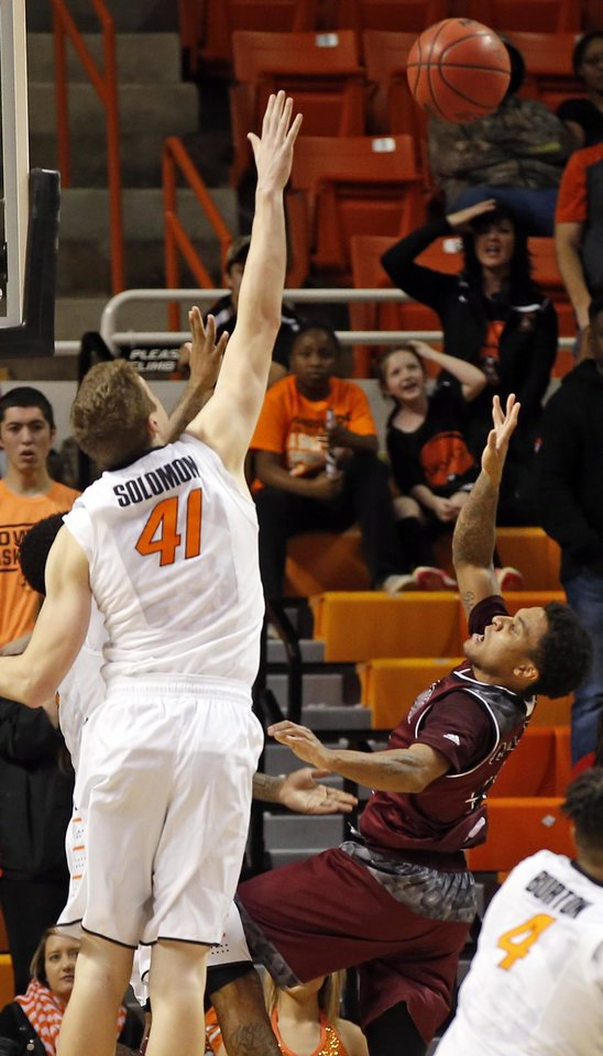 Photo - Missouri State's Dequon Miller (4) takes the game winning shot against OSU's Mitchell Solomon (41) and Tyree Griffin (2), behind Solomon, during a men's college basketball game between Oklahoma State and Missouri State at Gallagher-Iba Arena in Stillwater, Okla., Saturday, Dec. 5, 2015. Missouri State won 64-63. Photo by Nate Billings, The Oklahoman