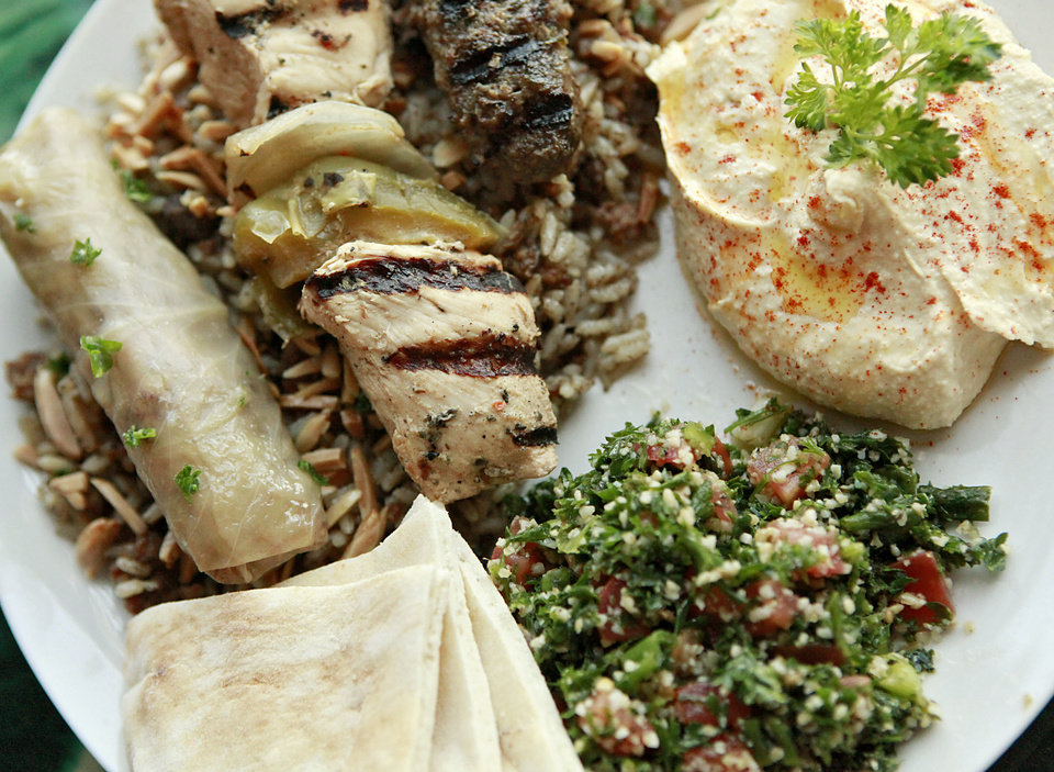 Photo -  The Sampler Plate at Nunu's Mediterranean Cafe includes a cabbage roll, chicken kebab, kafta, hummus, tabouli, and hashwa. [The Oklahoman Archives]