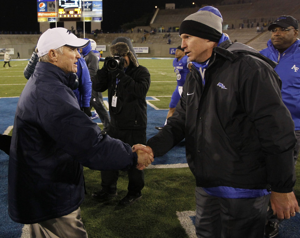 Photo -   Nevada head coach Chris Ault, left, shakes hands with Air Force head coach Troy Calhoun after Air Force's 48-31 victory in an NCAA college football game in Air Force Academy, Colo., on Friday, Oct. 26, 2012. (AP Photo/David Zalubowski)