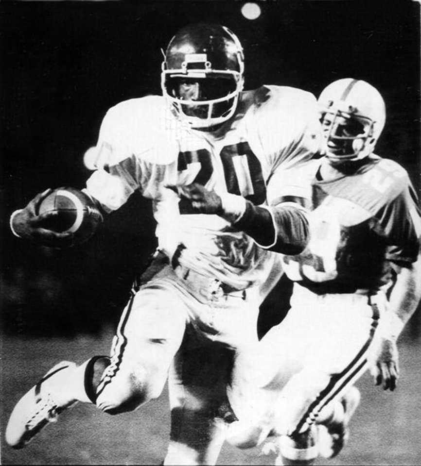 Photo -  UNIVERSITY OF OKLAHOMA: 1/2/79. Orange Bowl. OU-Nebraska.   Oklahoma halfback Billy Sims outruns Nebraska's Jim Pillen on his way to his first Orange Bowl touchdown as the Sooners downed the Huskers 31-24 in Miami.  Staff photo by Doug Hoke taken 1/1/79; photo ran in the 1/2/79 Daily Oklahoman. File:  College Football/OU/OU-Nebraska/Orange Bowl/Billy Sims/1979