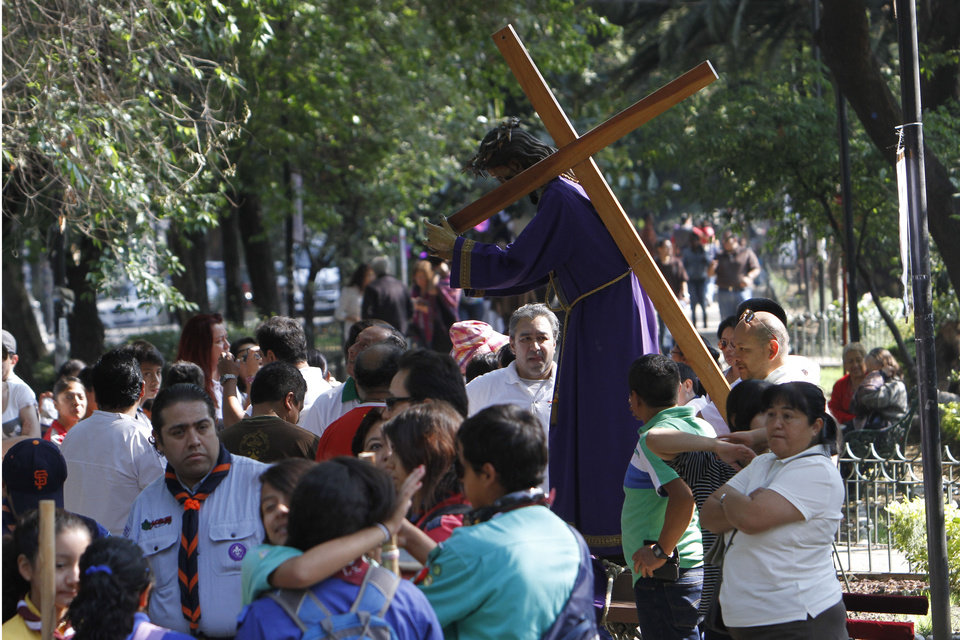 Photo - People who were participating in a Holy Week procession stop after a strong earthquake jolted Mexico City, Friday, April 18, 2014. A powerful magnitude-7.2 earthquake shook central and southern Mexico but there were no early reports of major damage or casualties. (AP Photo/Marco Ugarte)