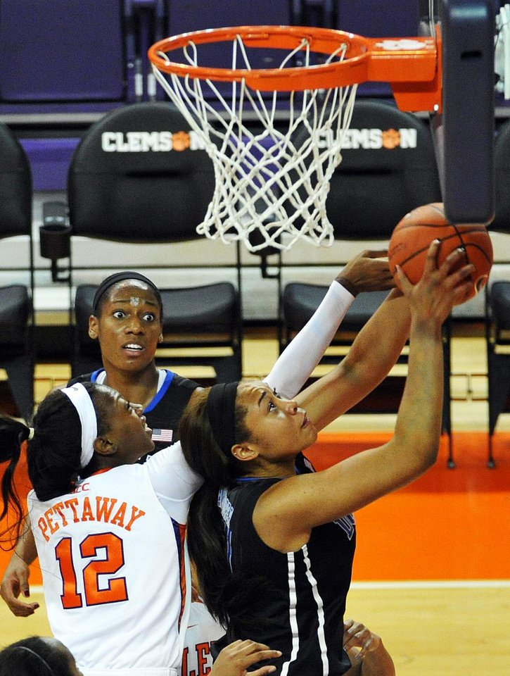 Photo - Duke's Kendall McCravey-Cooper, right, shoots as Clemson's Quinyotta Pettaway, front left, defends during the second half of an NCAA college basketball game on Thursday, Feb. 6, 2014, in Clemson, S.C. Duke won 78-51. (AP Photo/Rainier Ehrhardt)