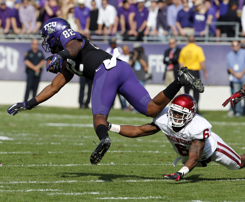 Oklahoma's Demontre Hurst (6) trips up TCU's Josh Boyce (82) during the college football game between the University of Oklahoma Sooners (OU) and the Texas Christian University Horned Frogs (TCU) at Amon G. Carter Stadium in Fort Worth, Texas, on Saturday, Dec. 1, 2012. Photo by Steve Sisney, The Oklahoman