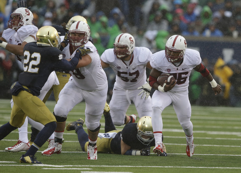Photo - Stanford running back Barry Sanders (26) runs during the first half of an NCAA college football game against Notre Dame Saturday, Oct. 4, 2014, in South Bend, Ind.   (AP Photo/Darron Cummings)
