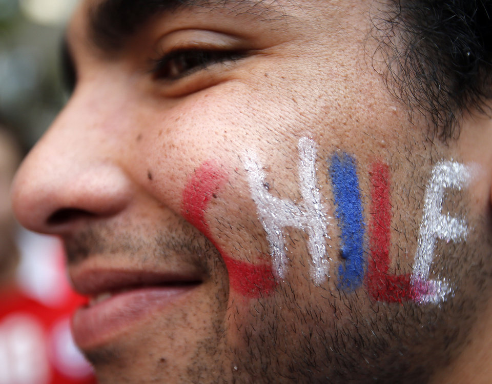Photo - A chile supporter with a painted cheek smiles prior  the group B World Cup soccer match between Spain and Chile at the Maracana Stadium in Rio de Janeiro, Brazil, Wednesday, June 18, 2014.  (AP Photo/Frank Augstein)