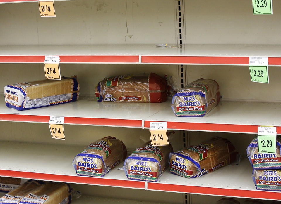 Bread supply on these shelves has been depleted. The threat of a severe winter storm, expected to arrive in Oklahoma City on Christmas Day,  sent hundreds of shoppers scurrying in the aisles at Crest Foods, 15th and Santa Fe in Edmond Monday, Dec. 24, 2012, Photo by Jim Beckel, The Oklahoman