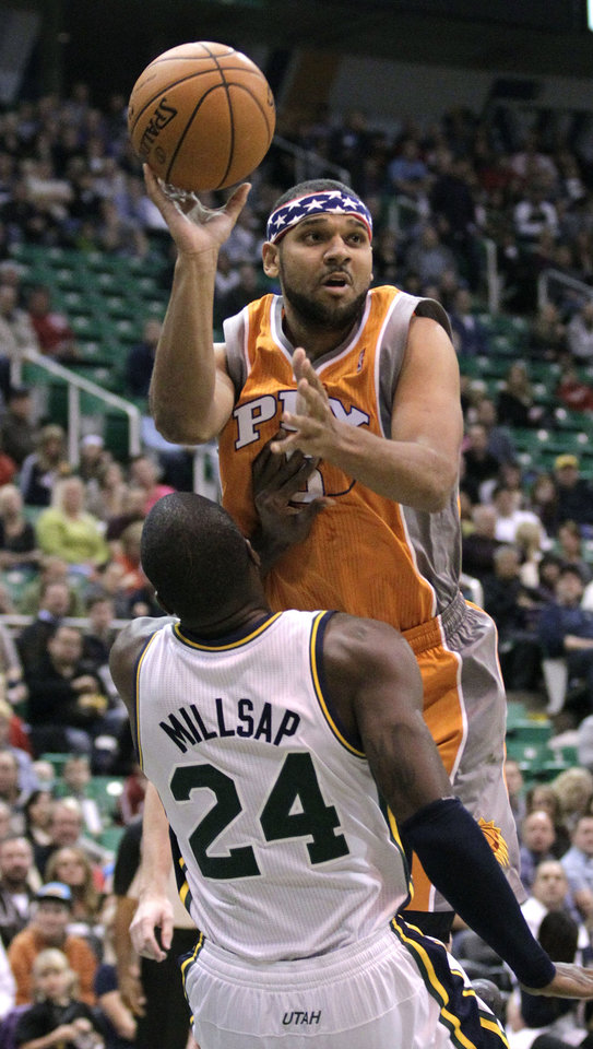 Photo -   Phoenix Suns shooting guard Jared Dudley (3) charges in to Utah Jazz power forward Paul Millsap (24) in the first quarter during an NBA basketball game on Saturday, Nov. 10, 2012, in Salt Lake City. (AP Photo/Rick Bowmer)