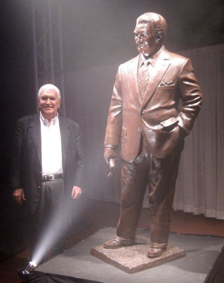 LEE ALLAN SMITH DAY....Lee Allan Smith poses with his statue by Mike  Wimmer which will be placed at the Gaylord -Pickens Museum of the  Oklahoma Heritage Center. (Photo by Helen Ford Wallace).