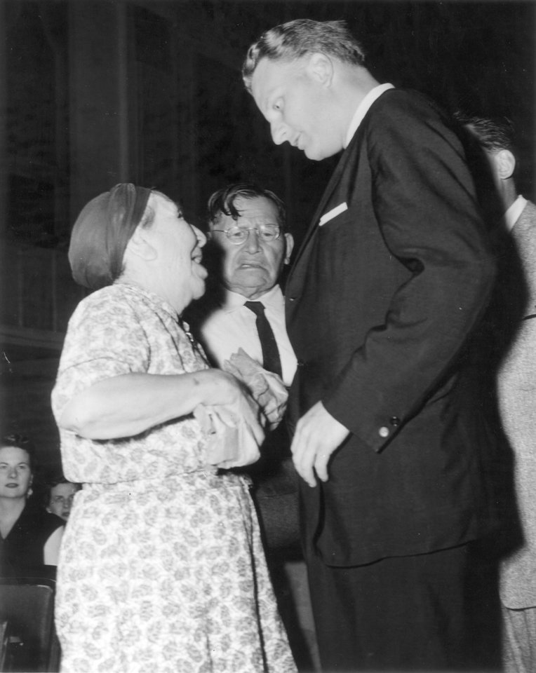 Photo - Evangelist Billy Graham visits with some admirers in Oklahoma City.  Staff photo taken 6/25/1956.