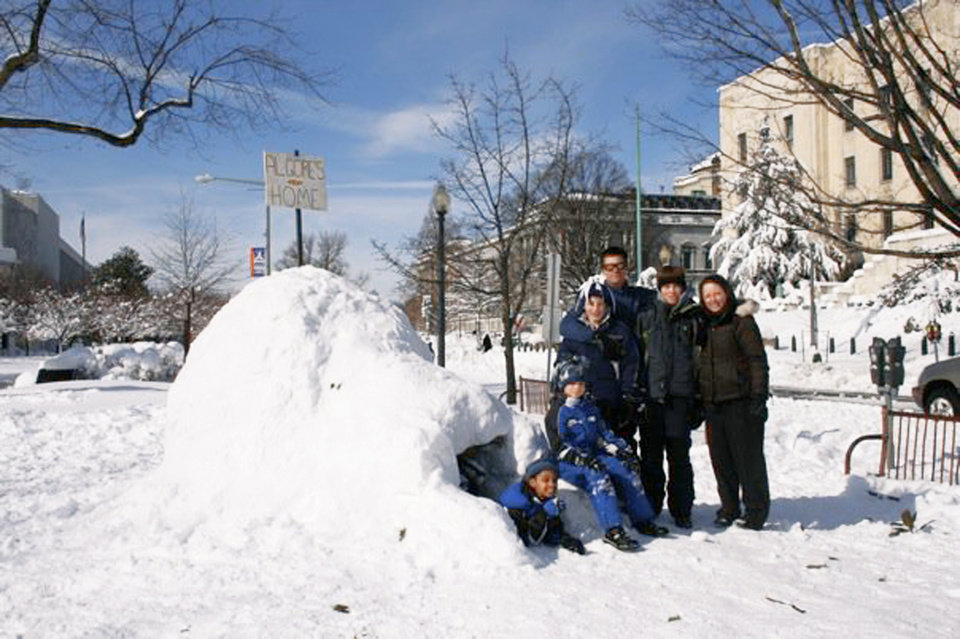 Sen. Jim Inhofe's daughter, Molly Rapert, far right, and family, Zegita Marie, Jonah, Luke, husband Jimmy, and Jase, built an igloo Saturday in Washington, D.C., with signs poking fun at global warming.  Photo provided by Rapert family