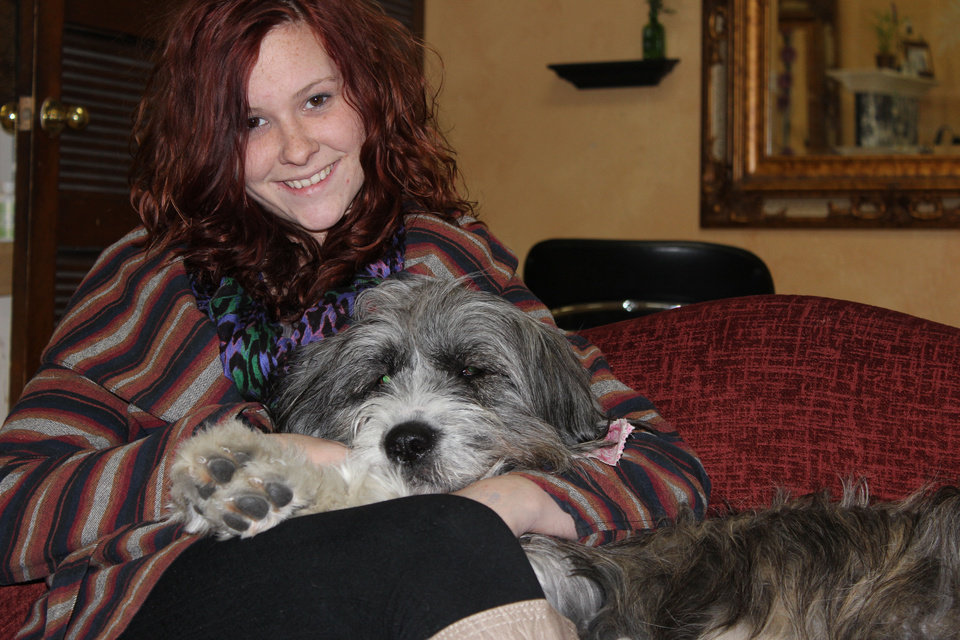 Photo - Peyton Taylor and her bearded collie Winn Dixie.  Photo by Chris Jones, for The Oklahoman.