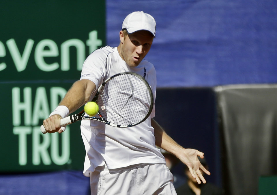 Photo - Britain's Dominic Inglot returns a shot from the United States team during a doubles match at the Davis Cup tennis matches, Saturday, Feb. 1, 2014, in San Diego. (AP Photo/Lenny Ignelzi)