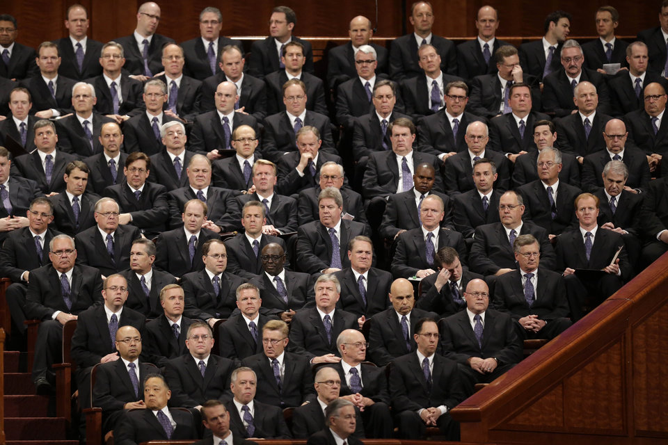 Photo - Members of the Mormon Tabernacle Choir look on during the 183rd Annual General Conference of The Church of Jesus Christ of Latter-day Saints Saturday, April 6, 2013, in Salt Lake City. The Mormon church is planning to build two new temples in Rio de Janeiro and Cedar City, Utah. The faith's president, Thomas S. Monson, announced the new temples on Saturday during the 183rd semi-annual general conference of The Church of Jesus Christ of Latter-day Saints. More than 100,000 members of the church have gathered in Salt Lake City to hear words of inspiration and guidance for daily living from the faith's senior leaders.  (AP Photo/Rick Bowmer)