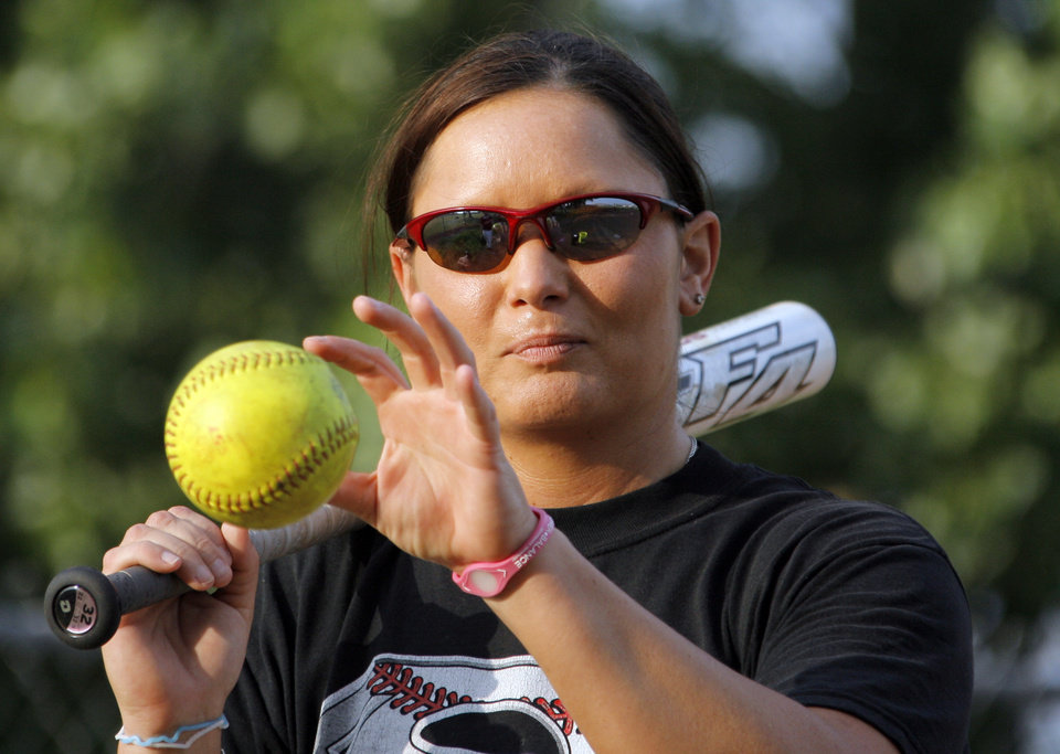 Photo - Coach Mandy Fulton catches a ball before hitting it during a fielding exercise at practice for the OKC Strikkers softball team in Oklahoma City, Thursday, May 27, 2010.  Mandy Fulton was a member of OU's national championship softball team in 2000. Photo by Nate Billings, The Oklahoman