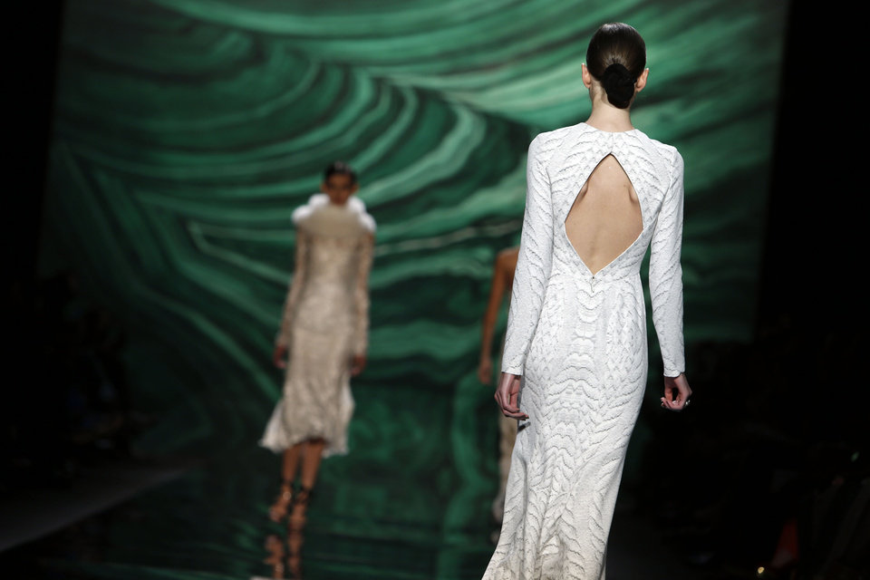 Photo - The Monique Lhuillier Fall 2013 collection is modeled during Fashion Week, Saturday, Feb. 9, 2013 in New York.  (AP Photo/Jason DeCrow)