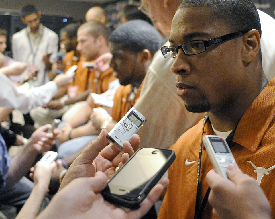 Photo - Texas linebacker Keenan Robinson answers questions during NCAA college football Big 12 Media Days, Monday, July 25, 2011, in Dallas. (AP Photo/Matt Strasen)