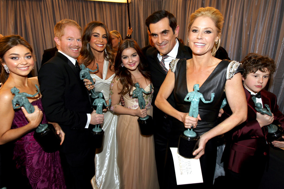 Actors Sarah Hyland, from left, Jesse Tyler Ferguson, Sofia Vergara, Ariel Winter, Ty Burrell, Julie Bowen and Nolan Gould pose backstage with the award for outstanding ensemble in a comedy series for �Modern Family� at the 19th Annual Screen Actors Guild Awards at the Shrine Auditorium in Los Angeles on Sunday Jan. 27, 2013. (Photo by Matt Sayles/Invision/AP)