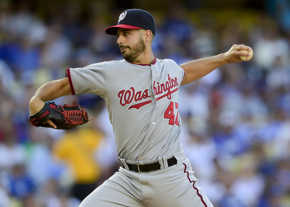 Photo - Washington Nationals Gio Gonzalez pitches in the first inning of a baseball game against the Los Angeles Dodgers, Monday, Sept. 1, 2014, in Los Angeles. (AP Photo/Gus Ruelas)