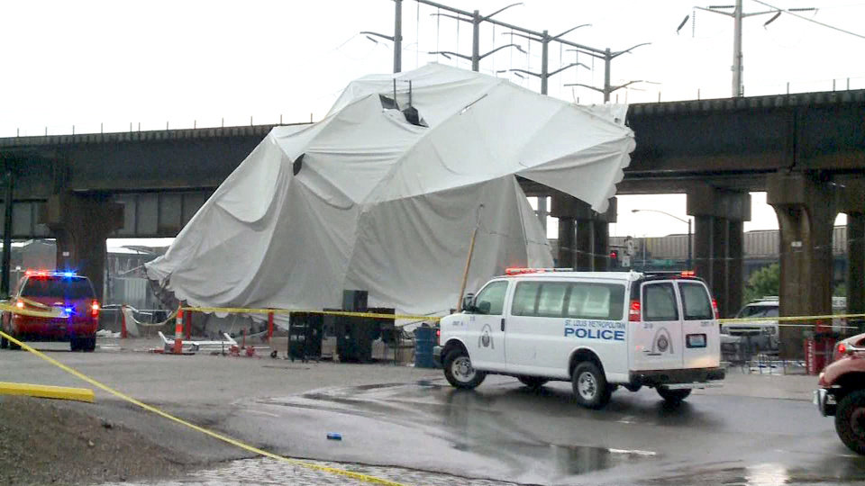 Photo -   Officials respond to the scene where a tent blew over after high winds crossed the area, Saturday, April 28, 2012, in St. Louis. The tent was set up next to Kilroy's Sports Bar, where St. Louis Fire Chief Dennis Jenkerson said a few hundred people were celebrating after the St. Louis Cardinals beat the Milwaukee Brewers in a baseball game. KSDK reported that fire officials said five people were in critical condition and 100 people were treated at the scene. (AP Photo/KSDK-TV)