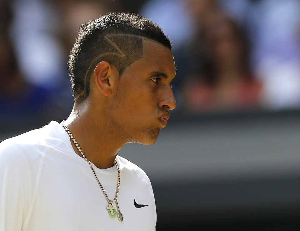Photo - Nick Kyrgios of Australia reacts after losing a point to Rafael Nadal of Spain during their men's singles match at the All England Lawn Tennis Championships in Wimbledon, London, Tuesday, July 1, 2014. (AP Photo/Ben Curtis)