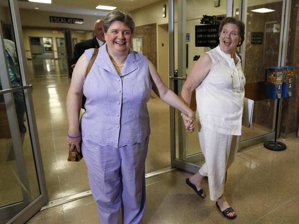 Photo - Sharon Baldwin (left) and Mary Bishop (right), two Tulsa women at the center of a gay marriage case that was appealed to the Supreme Court, prepare to apply for a marriage license on Monday, October 6, 2014 at the Tulsa County Courthouse in Tulsa, Okla. MATT BARNARD/Tulsa World