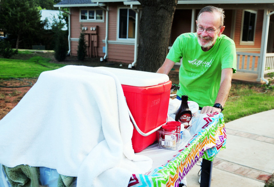 John Wolfe, an Oakcreek Cohousing Community resident, pushes a cart filled with homemade ice cream to the community clubhouse on Sept. 12, 2013 in Stillwater, Okla. Photo by KT King/For the Oklahoman