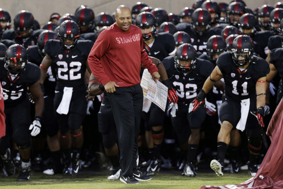 Photo -   Stanford head coach David Shaw leads his team onto the field at the start of an NCAA college football game against Duke in Stanford, Calif., Saturday, Sept. 8, 2012. (AP Photo/Marcio Jose Sanchez)