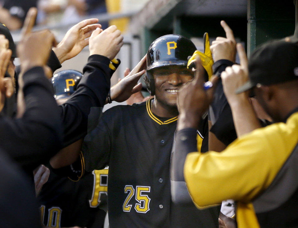 Photo - Pittsburgh Pirates' Gregory Polanco (25) is greeted by teammates in the dugout after hitting a three-run home run against the New York Mets in the fifth inning of a baseball game  Thursday, June 26, 2014, in Pittsburgh. (AP Photo/Keith Srakocic)