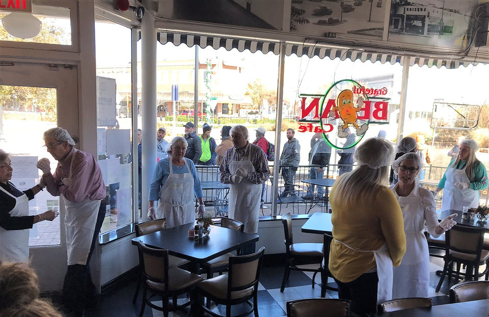Photo -  Volunteers gather on Thanksgiving at Kaiser's Grateful Bean as folks line up for the first-ever Luke Cathey Memorial Thanksgiving Day Meal. [Photo by Dave Cathey, The Oklahoman]
