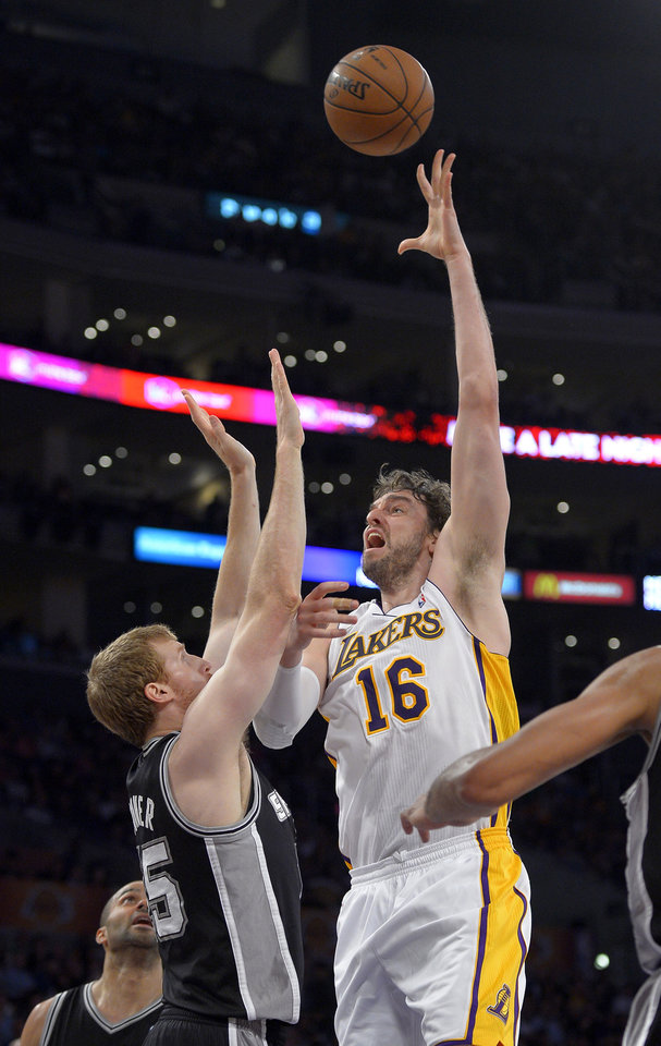 Photo - Los Angeles Lakers forward Pau Gasol, right, of Spain, shoots as San Antonio Spurs forward Matt Bonner defends during the first half in Game 4 of a first-round NBA basketball playoff series, Sunday, April 28, 2013, in Los Angeles. (AP Photo/Mark J. Terrill)