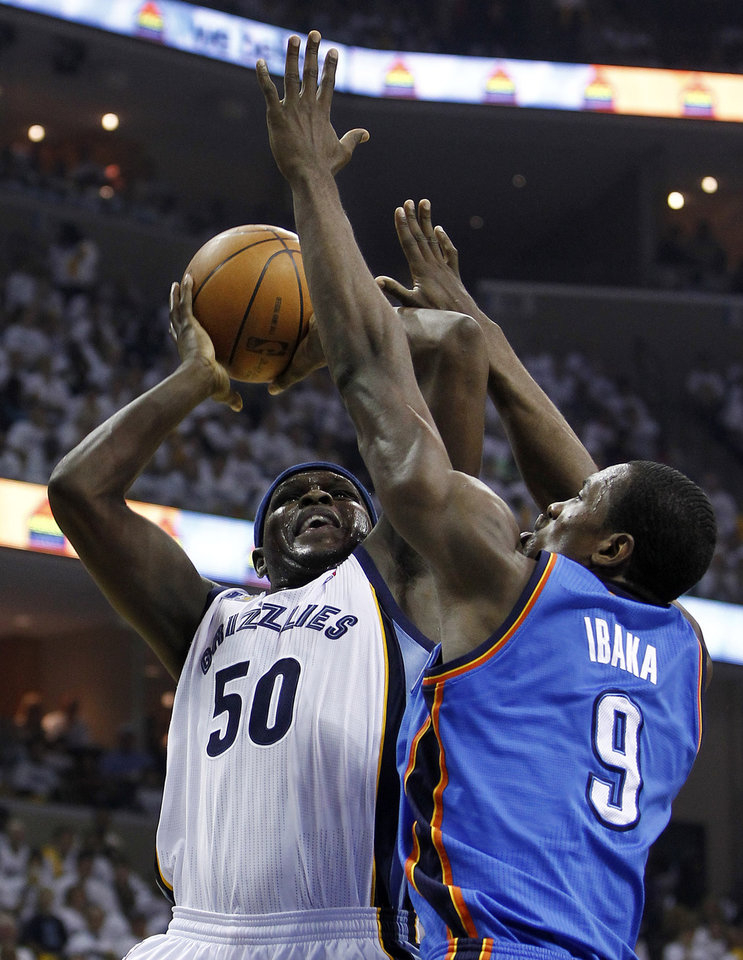 Memphis Grizzlies forward Zach Randolph (50) shoots against Oklahoma City Thunder forward Serge Ibaka (9) during the first half of Game 6 of a second-round NBA basketball playoff series on Friday, May 13, 2011, in Memphis, Tenn. (AP Photo/Wade Payne)