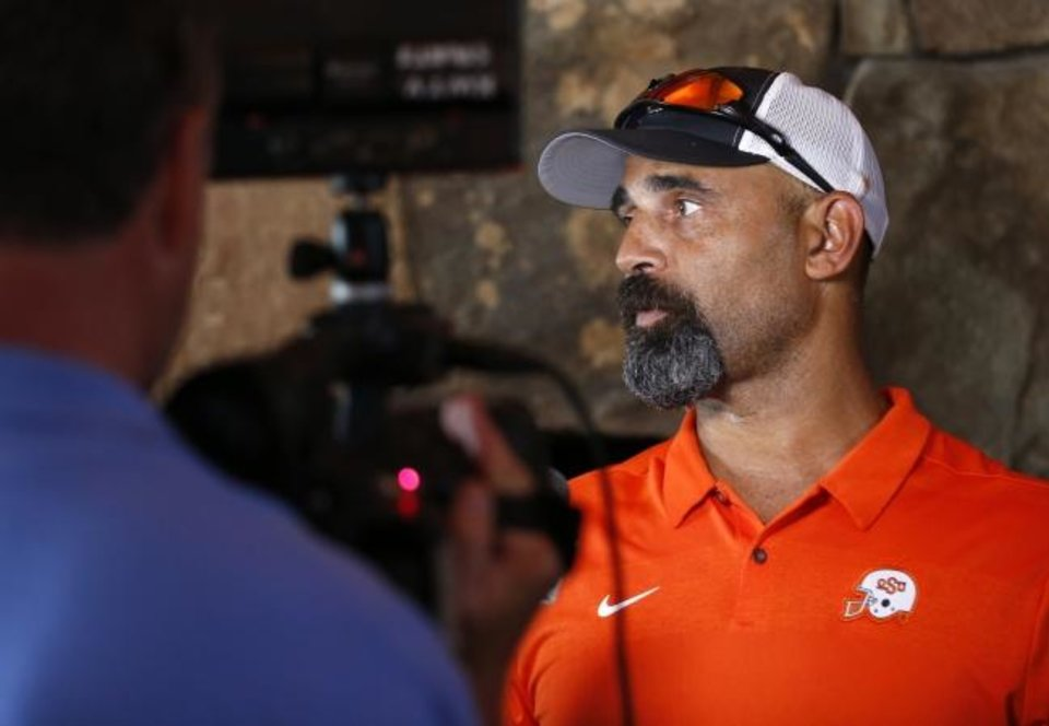 Photo -  Oklahoma State associate head coach and receivers coach Kasey Dunn hoped to get the offensive coordinator's job after Mike Yurcich left. But after being bypassed, Dunn decided to stay for the same reason he tries to convince players to come to Stillwater -- it's a good fit. [NATE BILLINGS/THE OKLAHOMAN]