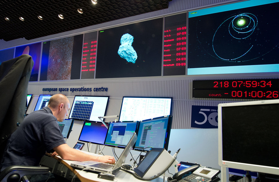 Photo - An expert watches his screens at the control center of the European Space Agency, ESA, in Darmstadt, Germany, Wednesday, Aug. 6, 2014. A mission to land the first space probe on a comet reaches a major milestone when the unmanned Rosetta spacecraft finally catches up with its quarry on Wednesday. It's a hotly anticipated rendezvous: Rosetta flew into space more than a decade ago and had to perform a series of complex maneuvers to gain enough speed to chase down comet 67P/Churyumov-Gerasimenko on its orbit around the sun. (AP Photo/dpa, Boris Roessler)
