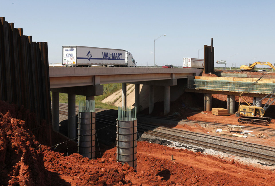 Photo - Construction is proceeding in the widening of the Kilpatrick Turnpike in Oklahoma City, OK, Saturday, September 1, 2012. This section is crossing over the Santa Fe Railroad tracks.  By Paul Hellstern, The Oklahoman