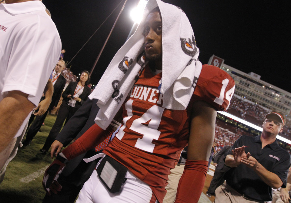 Photo - Oklahoma's Aaron Colvin (14) walks off the field after the 24-19 loss to Kansas State during the college football game between the University of Oklahoma Sooners (OU) and the Kansas State University Wildcats (KSU) at the Gaylord Family-Memorial Stadium on Saturday, Sept. 22, 2012, in Norman, Okla. Photo by Chris Landsberger, The Oklahoman
