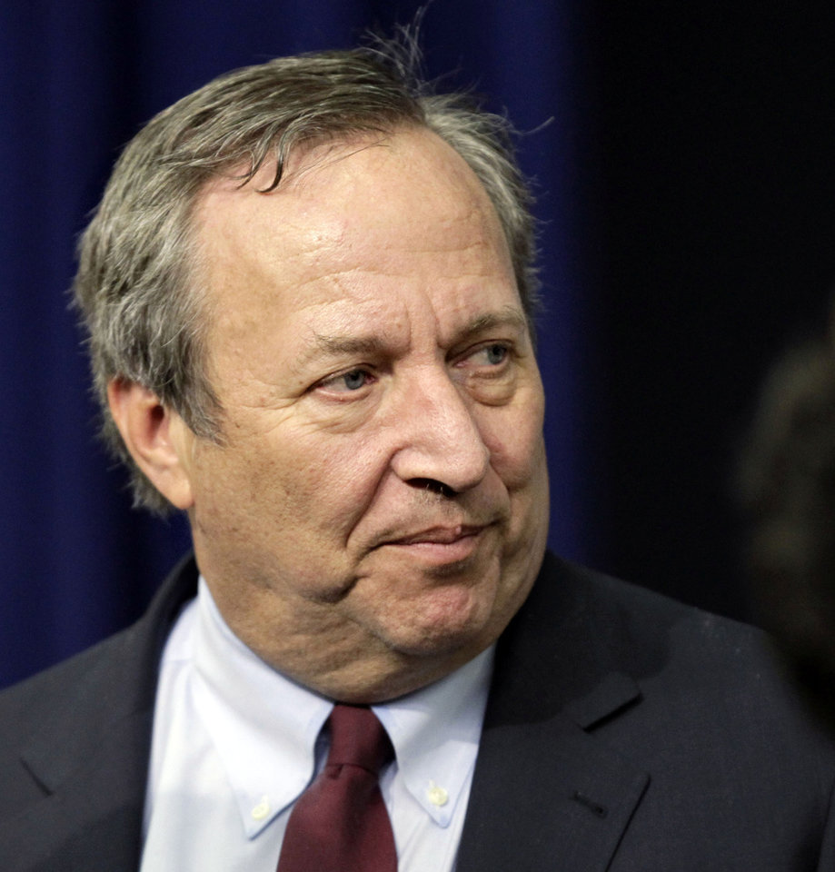 Photo - File- This Dec. 17, 2010 file photo shows Director of the National Economic Council Lawrence Summers arriving for the tax cut extension bill  during a ceremony at the Eisenhower Executive Office Building in the White House complex in Washington. President Barack Obama says he has accepted Lawrence Summers' decision to withdraw from consideration for the role of Chairman of the Federal Reserve. Obama says Summers was a critical member of his economic team and says he is grateful for his service on behalf of the country. Summers was the leading candidate to replace current Fed Chairman Ben Bernanke but faced opposition from some Democrats. (AP Photo/J. Scott Applewhite, File)