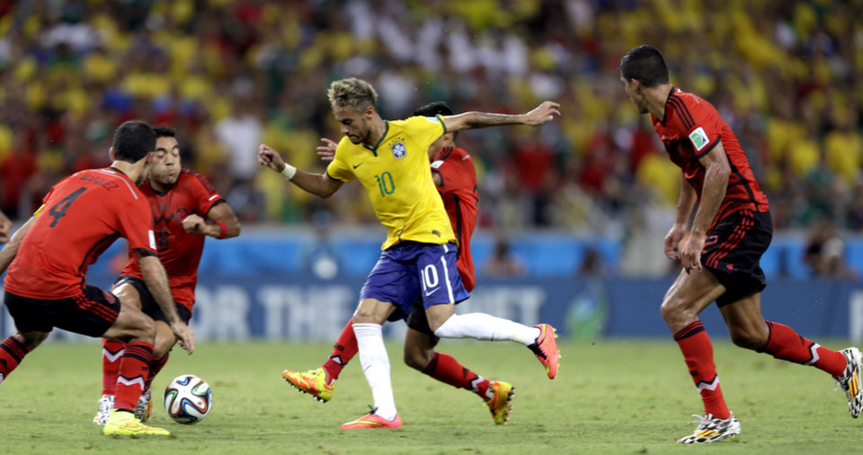 Photo - Brazil's Neymar is closed down by the Mexico defense during the group A World Cup soccer match between Brazil and Mexico at the Arena Castelao in Fortaleza, Brazil, Tuesday, June 17, 2014. (AP Photo/Andre Penner)