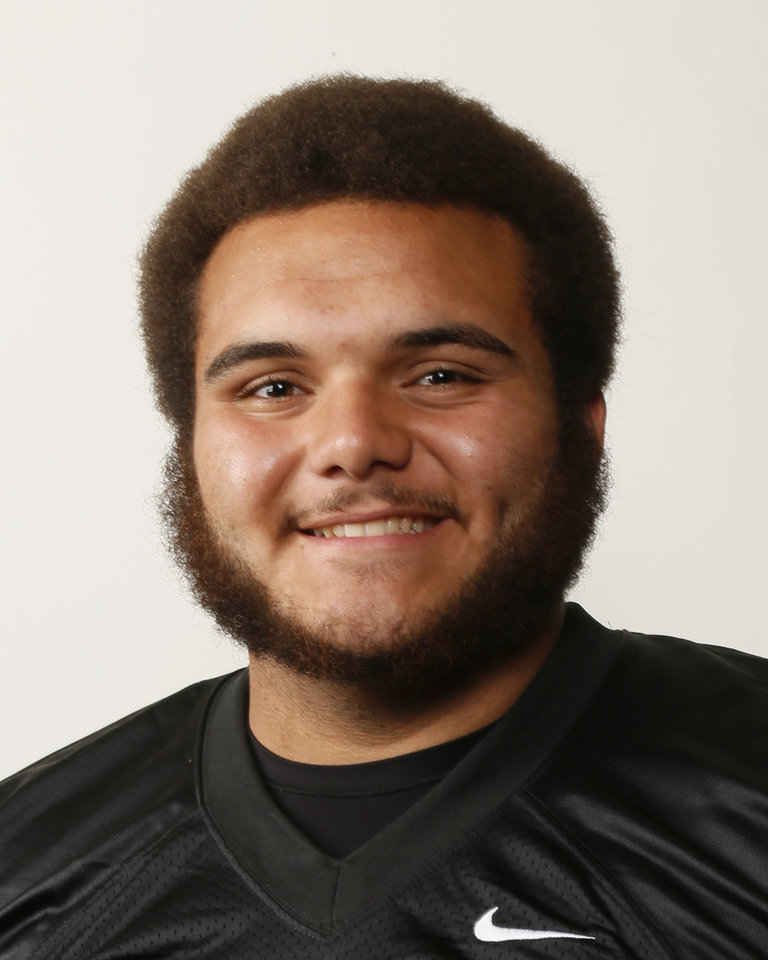 Photo - Carlos Freeman, Midwest City football player, poses for a mug shot during The Oklahoman's Fall High School Sports Photo Day in Oklahoma City, Wednesday, Aug. 15, 2012. Photo by Nate Billings, The Oklahoman