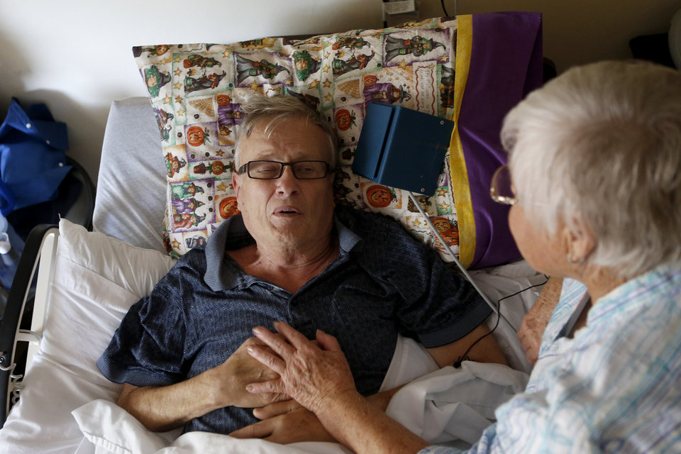 Bob Matthews is comforted by his wife, BJ Matthews, as he continues to recover from the effects of West Nile Virus in Oklahoma City, Friday, August 10, 2012. Photo by Bryan Terry, The Oklahoman