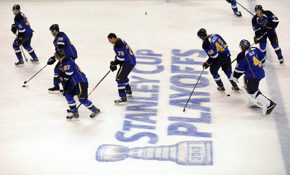 Photo - St. Louis Blues players warm up before Game 1 of their first-round NHL hockey Stanley Cup playoff series against the Los Angeles Kings, Tuesday, April 30, 2013, in St. Louis. (AP Photo/Bill Boyce)